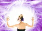 Beautiful woman over abstract purple background — Stock Photo