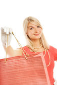 Beautiful young woman with a bags. Isolated on white background — Stock Photo