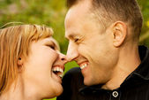 Couple in love outdoors. Close-up portrait. — Stock Photo