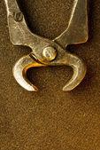 Old metal tongs — Stock Photo