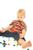 Thoughtful little child playing. Isolated on white background — Stock Photo