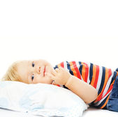 Beautiful young child waking up in the morning. Isolated on whit — Stock Photo
