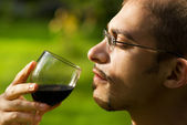 Professional sommelier tasting red wine. Close-up portrait. — Stock Photo