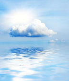 Small cloud and sun reflected in water — Stock Photo