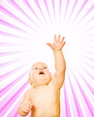 Little child over abstract pink background — Stock Photo