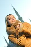 Beautiful blond girl wearing winter coat — Stock Photo