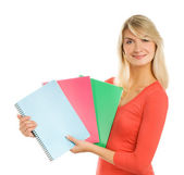 Attractive teenage girl with notebooks isolated on white backgro — Stock Photo