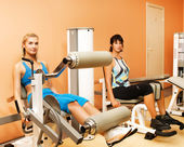 Tho women exercising in a sport club — Stock Photo