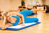Beautiful women exercising in fitness club — Stock Photo