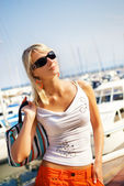Pretty young lady near the yachtclub — Stock Photo