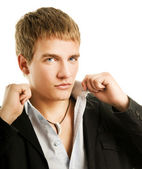 Handsome young man dressing up — Stock Photo