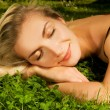 Beautiful young girl relaxing on a meadow — Stock Photo #4800465
