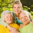 Stock Photo: Grandparents with granddaughter outdoors