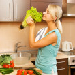 Beautiful young woman making vegetarian vegetable salad — Stock Photo #4800588