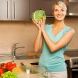 Beautiful young woman making vegetarian vegetable salad — Stock Photo #4800601