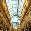 Famous shopping center Vittorio Emanuele II Shopping Gallery (Mi - Stock Photo