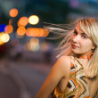 Beautiful sad girl in the city at night — Stock Photo