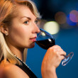 Beautiful young lady drinking red wine - Stock Photo
