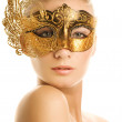 Lovely young woman with carnival mask on her face — Stock Photo #4800642