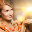 Beautiful woman holding magic lights in her hands — Stock Photo #4800709