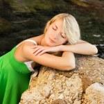 Beautiful young woman sleeps outdoors — Stock Photo #4800719
