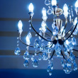 Stock Photo: Vintage crystal lamp toned in blue