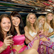 Group of beautiful women clinking glasses with champgagne inside — Stock Photo #4800741