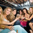 Group of beautiful women clinking glasses with champgagne inside — Stock Photo