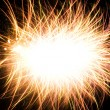 Abstract photo of fireworks with free space in the middle - Stock Photo
