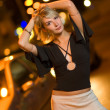 Beautiful young woman in a city at night — Stockfoto