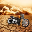 Motorcycle in a desert — Stock Photo