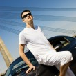Handsome man standing near the modern sport car — Stock Photo #4803860