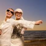 Two beautiful women relaxing near the ocean — Stock Photo #4803873