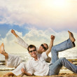 Young beautiful couple having fun on the beach — Stock Photo #4803891
