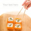 Sushi on a bamboo plate — Stock Photo