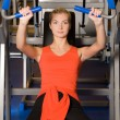 Stock Photo: Beautiful womworks out in gym