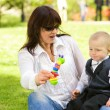 Mother with her child outdoors — Stock Photo #4803944