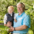 Stock Photo: Happy grandfather with his grandson outdoors