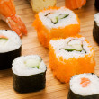 Different types of sushi on a bamboo plate - Stock Photo