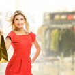 Beautiful young woman with a bag in a shop — Stock Photo #4803985