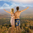 An attractive couple relaxing in high mountains — Stock Photo