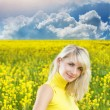 Beautiful young woman in a flower field — Stock Photo