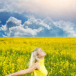 Happy young woman in a flower field — Stock Photo