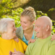 Grandparents with granddaughter outdoors — Stock Photo