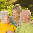 Grandparents with granddaughter outdoors — Stock Photo #4804035