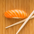 Sashimi with fresh salmon on bamboo plate - Stock Photo