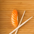 Sashimi with fresh salmon on bamboo plate — Stock Photo