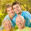 Young couple and their grandparents outdoors — Stock Photo