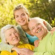 Grandparants with granddaughter outdoors — Stock Photo
