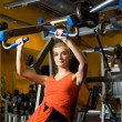 Beautiful woman works out in a gym — Stock Photo #4804172